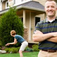 man standing outside family